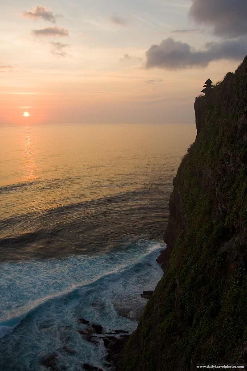 Sunset Dramatic Cliff Ocean Waves Hindu Temple - Uluwatu, Bali, Indonesia - Daily Travel Photos