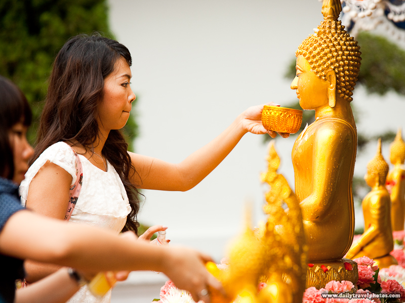 Beautiful Thai Woman Cleansing Buddha Statue - Bangkok, Thailand - Daily Travel Photos