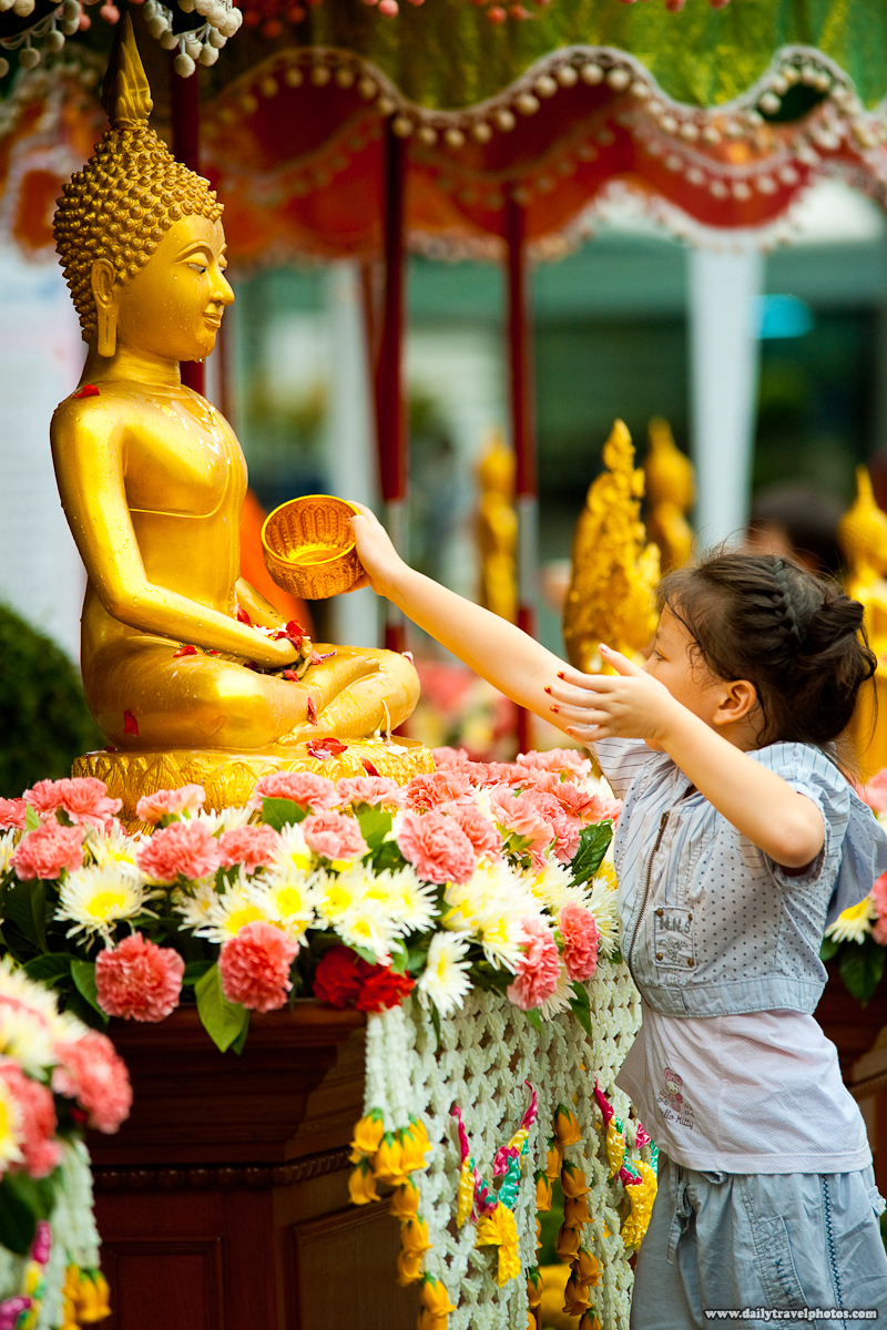 Young Thai Girl Bathing Buddha Statue Songkran - Bangkok, Thailand - Daily Travel Photos