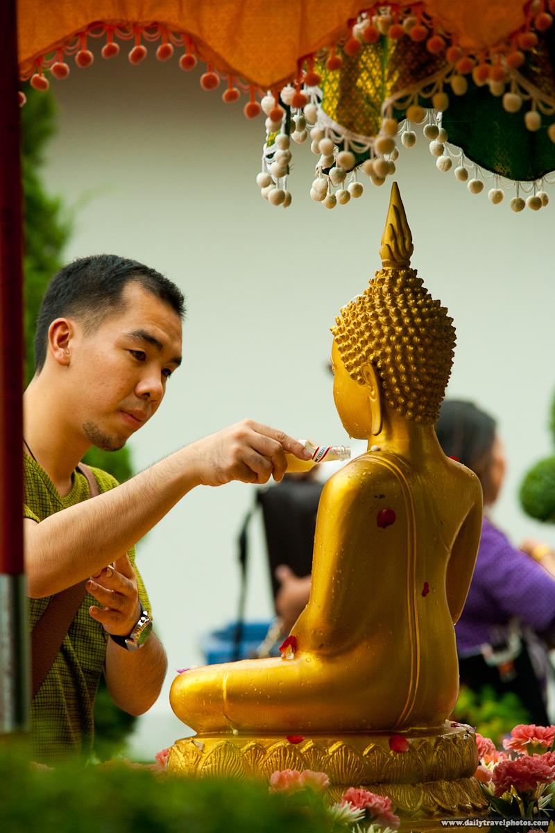 Thai Man Pour Perfume Scent Bottle Buddha Songkran - Bangkok, Thailand - Daily Travel Photos