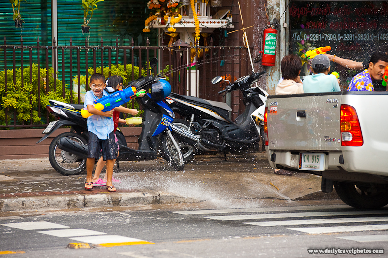 Songkran Water Festival Fight Thai New Year Truck Children Splash Guns - Bangkok, Thailand - Daily Travel Photos