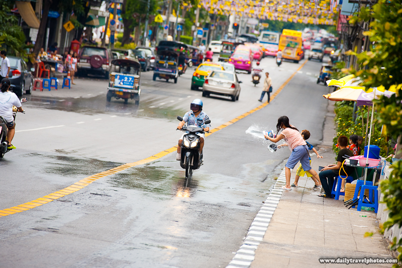 Motorcycle Rider Water Fight Songkran Long Street Tilted - Bangkok, Thailand - Daily Travel Photos