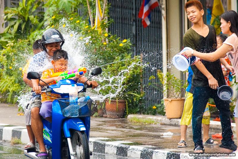 Songkran Motorcycle Family Water Gun Fight Splash Douse - Bangkok, Thailand - Daily Travel Photos