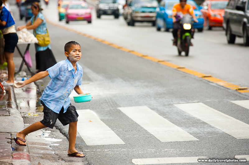 Boy Throwing White Talcum Powder Paste Songkran Roadside - Bangkok, Thailand - Daily Travel Photos
