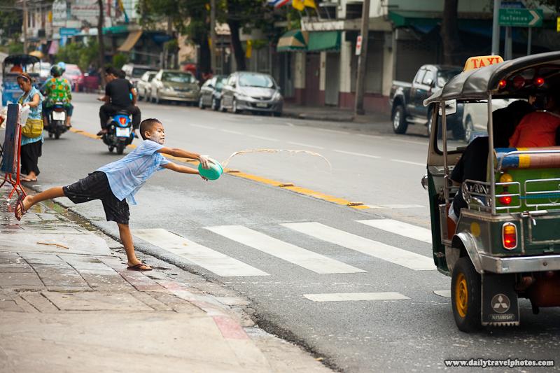 Songkran Festival Child Throw White Powder Water Paste Roadside - Bangkok, Thailand - Daily Travel Photos