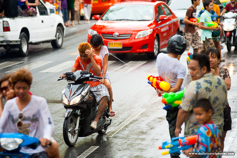 Behind Back Water Gun Attack Hits Motorcycling Targets Songkran Festival - Bangkok, Thailand - Daily Travel Photos