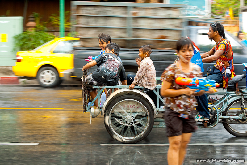 Thai Children Ride Front Carriage Motorcycle Water Guns Fight Songkran Festival - Bangkok, Thailand - Daily Travel Photos