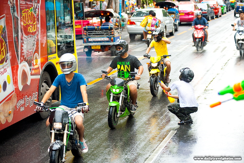 Songkran Water Fight Festival Motorcycle Shoot Gun Under Helmet Moving - Bangkok, Thailand - Daily Travel Photos