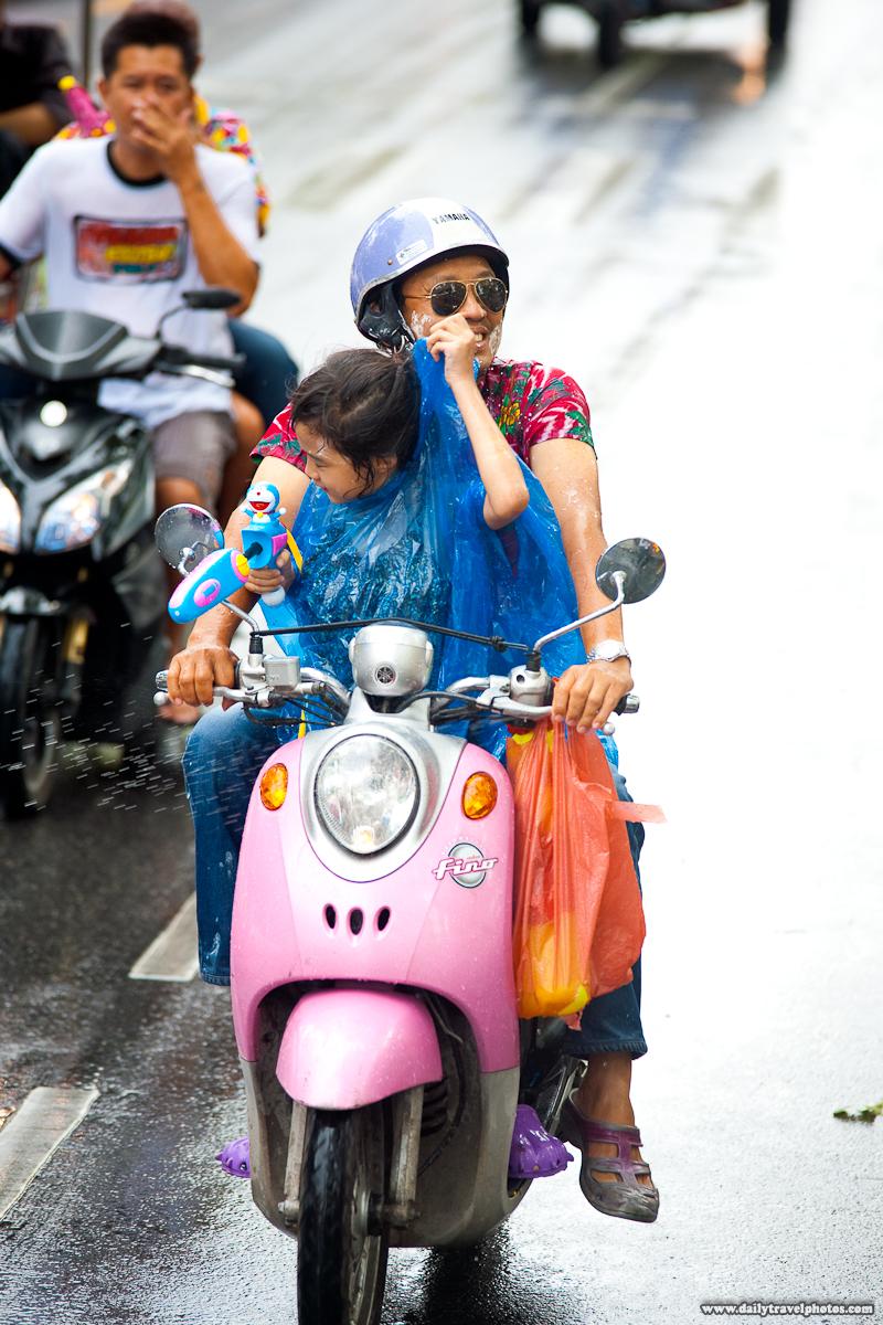 Young Thai Girl Passenger Songkran Water Fight Protection Raincoat - Bangkok, Thailand - Daily Travel Photos