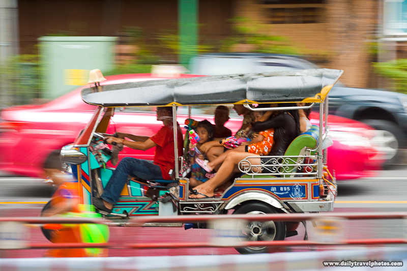 Songkran Water Fight Tuk Tuk Rolls By - Many Places, Around The World - Daily Travel Photos