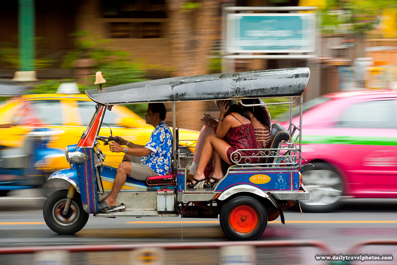 Thai Tuk Tuk Passengers Cower From Water Gun Attack Songkran Festival - Bangkok, Thailand - Daily Travel Photos