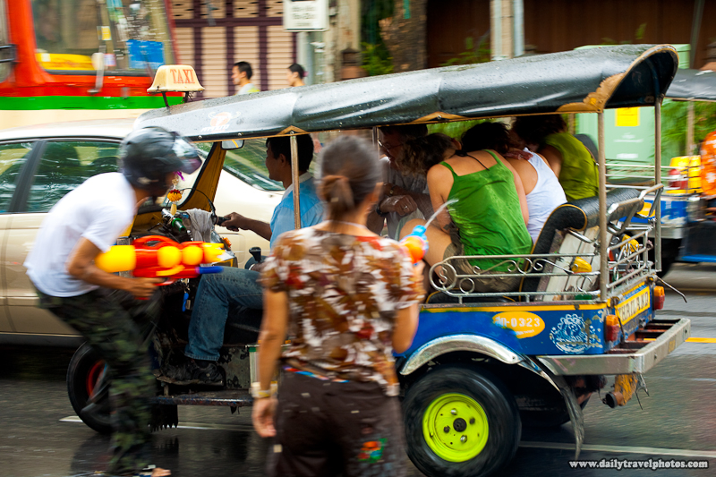 Foreign Tourists Under Heavy Water Attack Inside Their Tuk-Tuk - Bangkok, Thailand - Daily Travel Photos