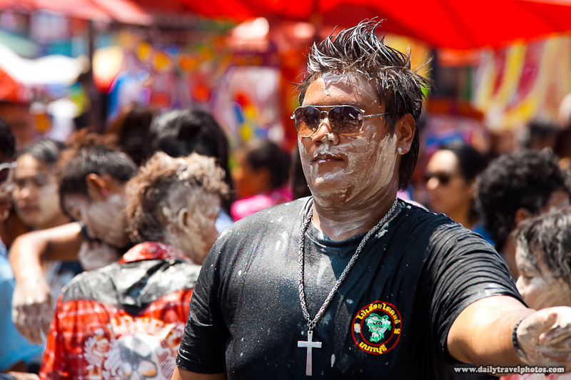 Thai Guy Covered In Talcum Powder Paste In a Sea of Thai People During Songkran - Bangkok, Thailand - Daily Travel Photos