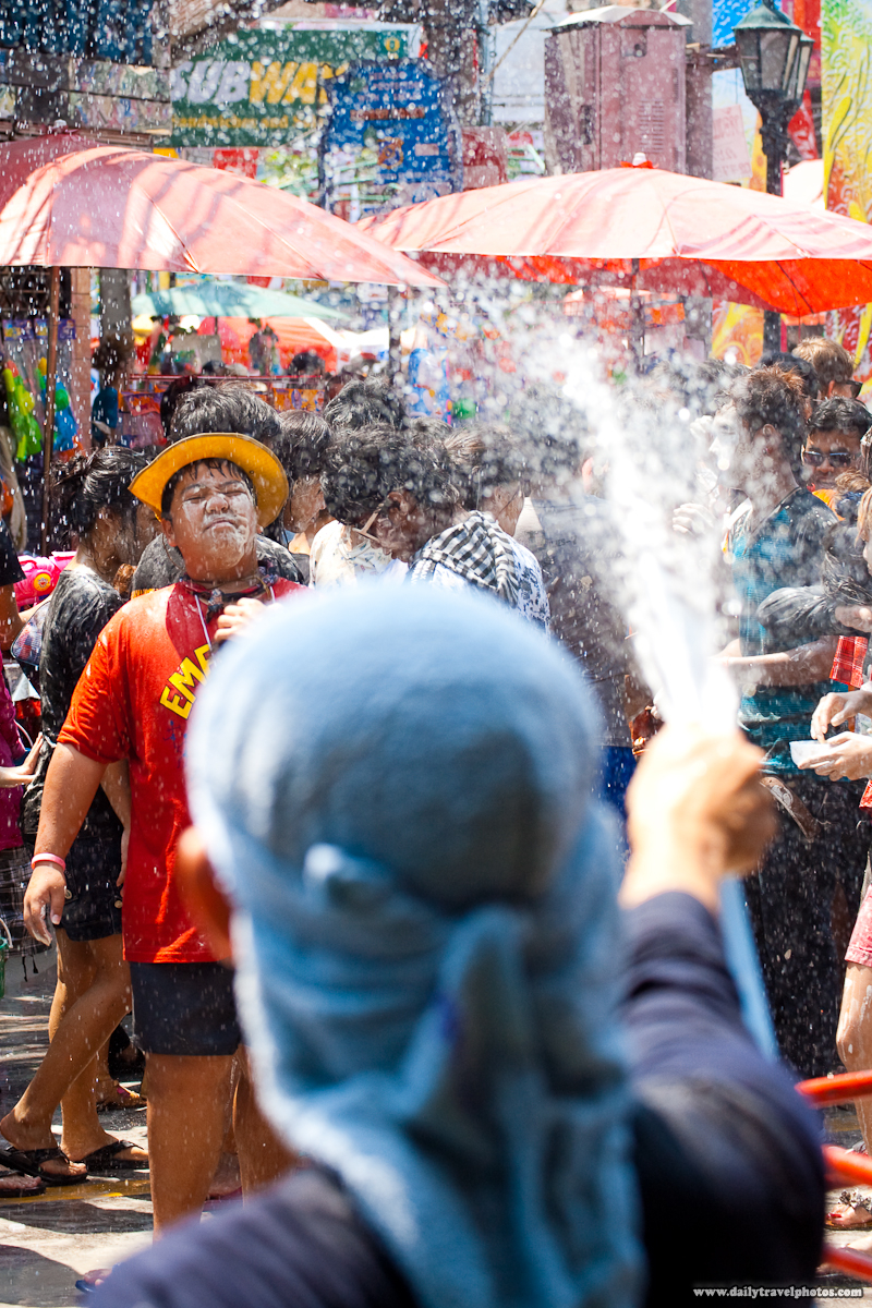 Thai Boy Receives Hose Water To Wash His Face During Songkran Water Festival - Bangkok, Thailand - Daily Travel Photos