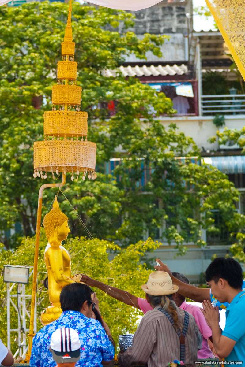 Closeup Phra Puttha Sihing Buddha Statue Perfume Water Flying Songkran City Hall - Bangkok, Thailand - Daily Travel Photos