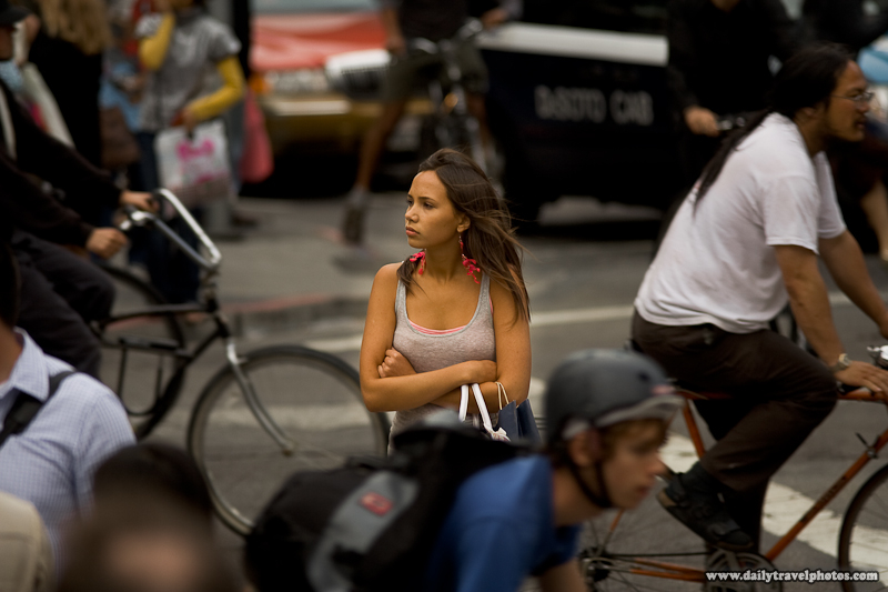 Beautiful Young Tourist Caught Amidst Critical Mass Bicycle Traffic - San Francisco, California, USA - Daily Travel Photos