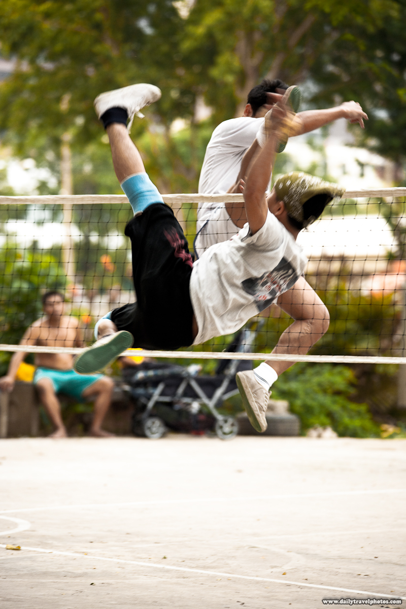 Takraw Foot Volleyball Player Spikes Ball At Opponent - Bangkok, Thailand - Daily Travel Photos