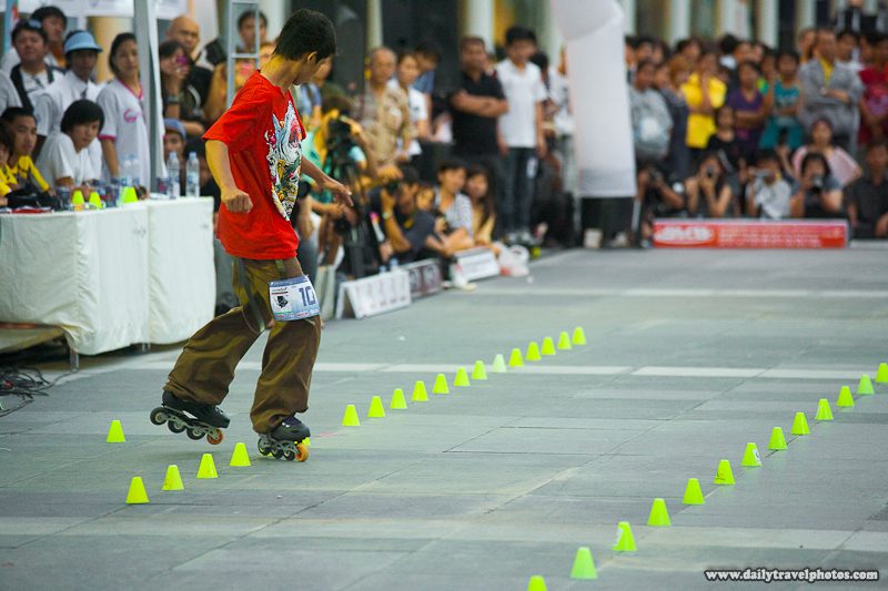 Slalom Inline Skater Sideways Scissors Maneuvering Through Small Pylons - Bangkok, Thailand - Daily Travel Photos