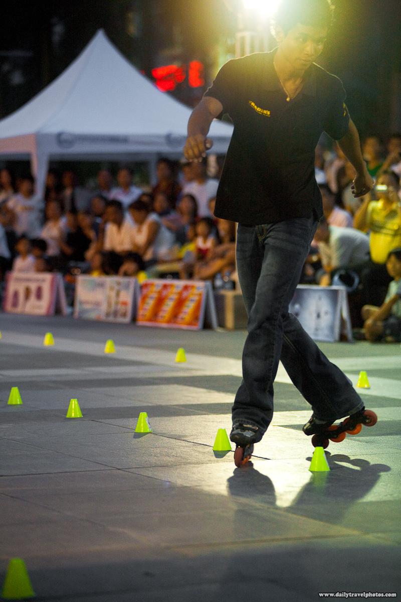 Slalom Skater Slides Backwards Through Pylons at Central World Mall - Bangkok, Thailand - Daily Travel Photos