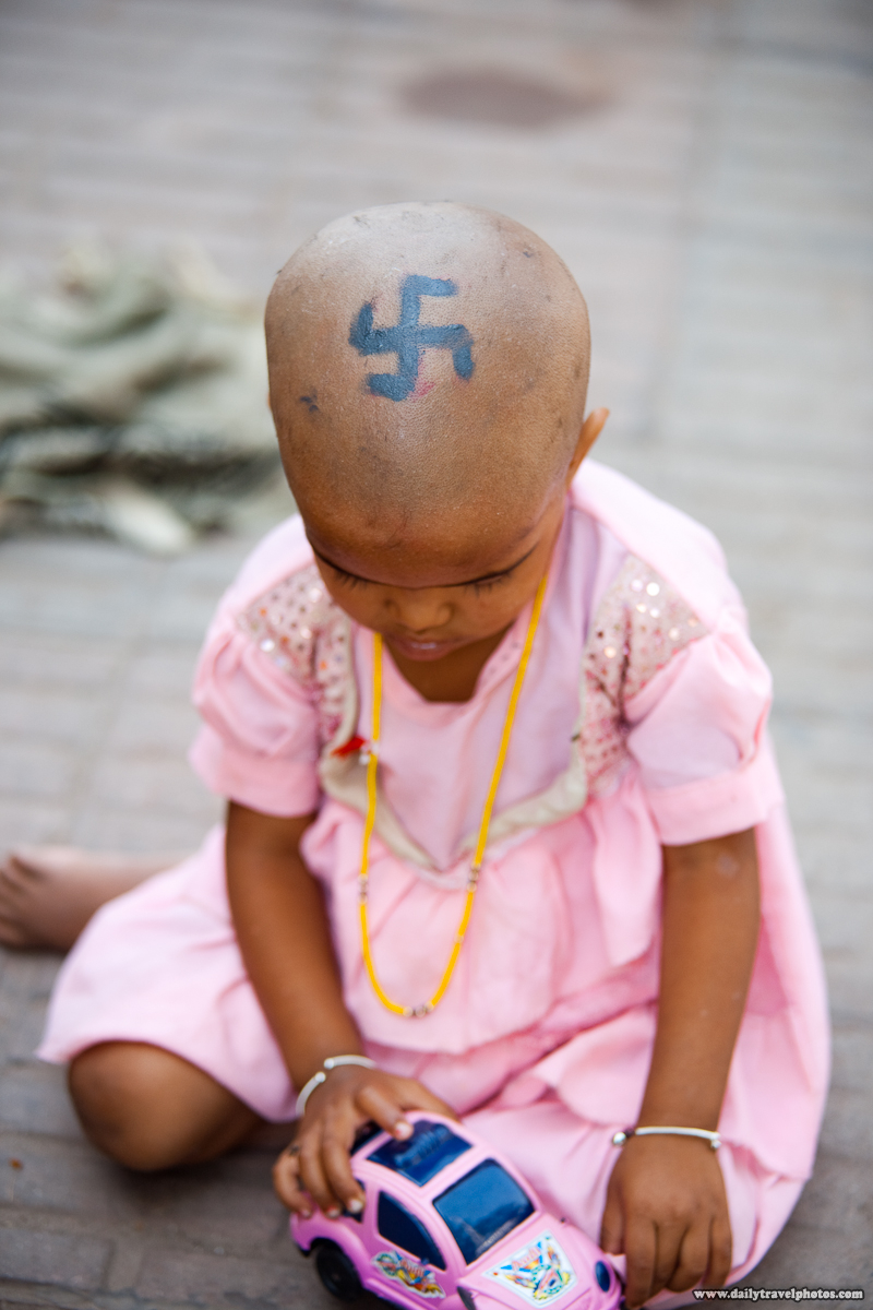 Recently Shaved Hindu Girl with Swastika Painted on Head - Haridwar, Arunachal Pradesh, India - Daily Travel Photos