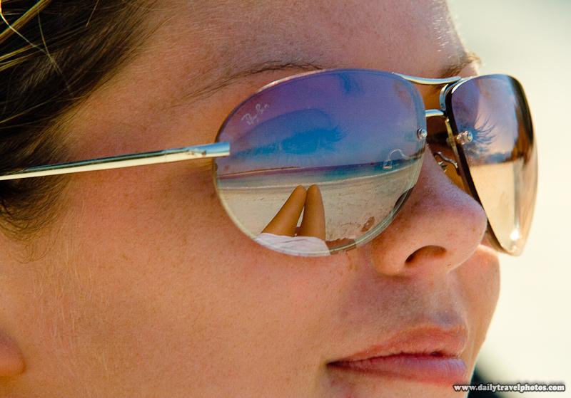 Reflection in Sunglasses of Beach and British Backpacker Female  - Gili Trawangan, Lombok, Indonesia - Daily Travel Photos