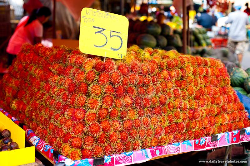 A Hairy Thai Fruit, Rambutan, Neatly Piled At Fruit Market - Bangkok, Thailand - Daily Travel Photos