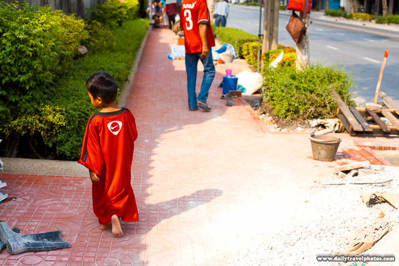 Young Thai Boy In Oversized Shirt Walking Calmly - Bangkok, Thailand - Daily Travel Photos