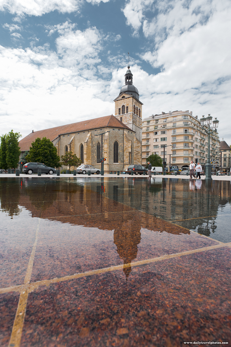 Cathédrale Saint-Pierre d'Annecy or Annecy Cathedral Reflected in Surface of a Water Fountain - Annecy, Haute-Savoie, France - Daily Travel Photos