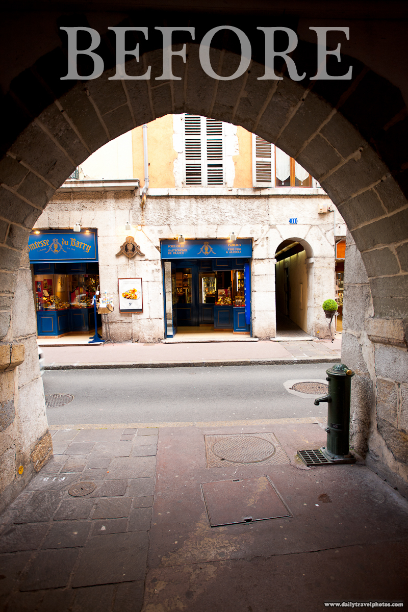 Storefront in Old Town Through a Beautiful Ancient Arch Before Post-Processing - Annecy, Haute-Savoie, France - Daily Travel Photos