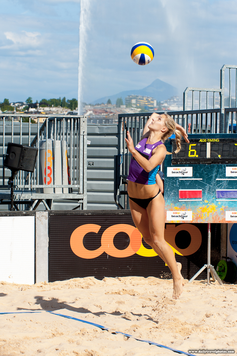 Swiss Women's Beach Volleyball Player Jump Service - Geneva, Switzerland - Daily Travel Photos