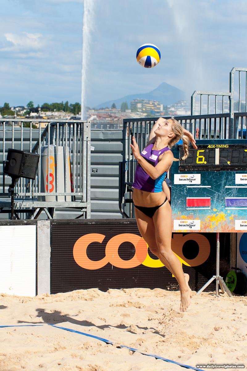 Swiss Women's Beach Volleyball Player Jump Service - Geneva, Switzerland - Daily Travel Photos