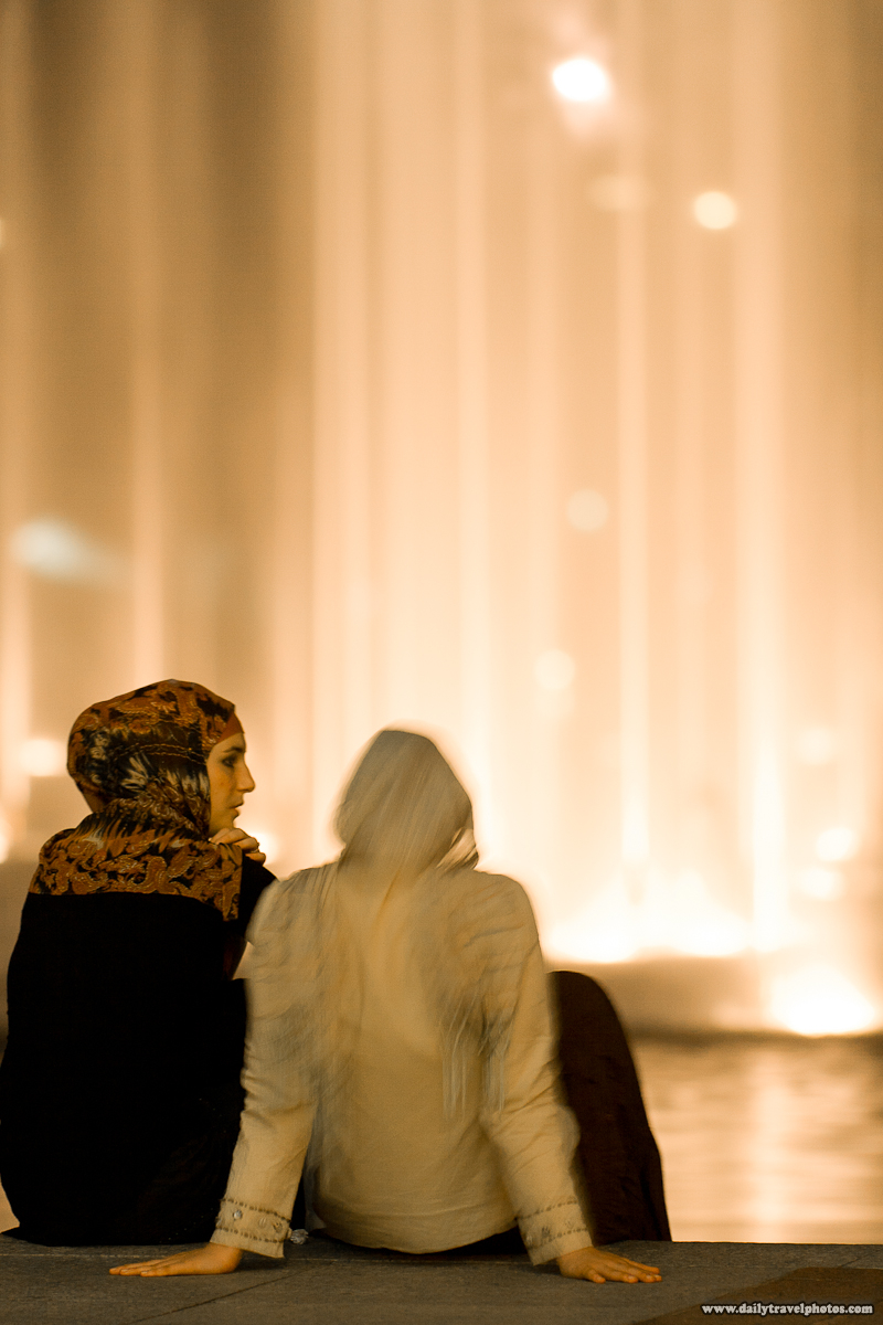 Two Female Arab Tourists In Traditional Scarves and Dresses In Front of KLCC Water Fountain - Kuala Lumpur, Malaysia - Daily Travel Photos