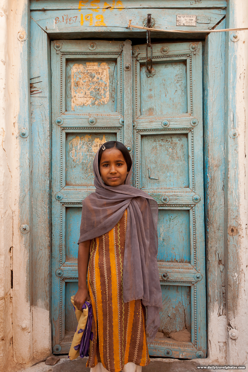 Cute Indian Girl Posing In Shalwar Kameez in Front of Old House Door - Bijapur, Karnataka, India - Daily Travel Photos