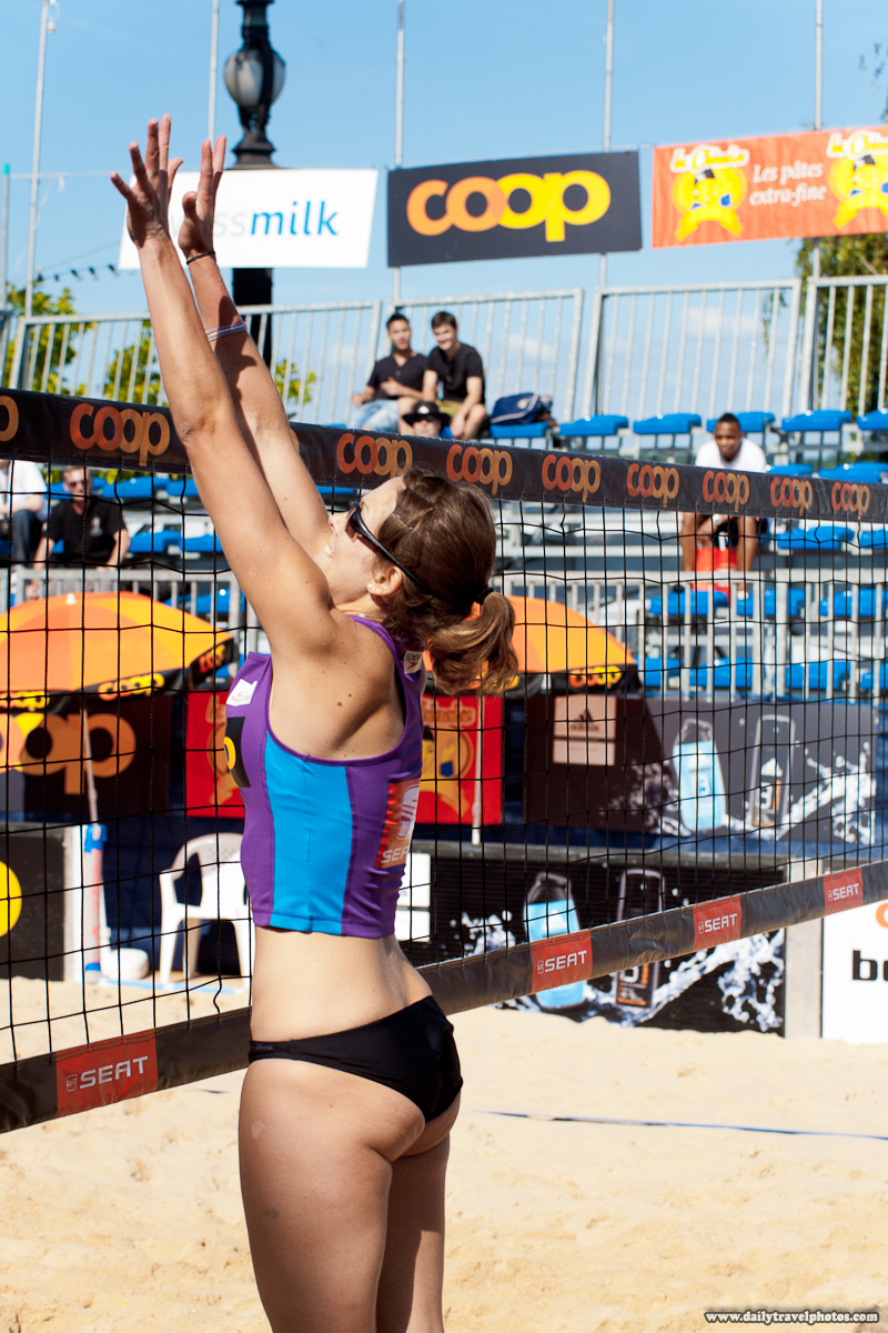 Beautiful Women's Beach Volleyball Player Jumps at Net to Block a Spike - Geneva, Switzerland - Daily Travel Photos