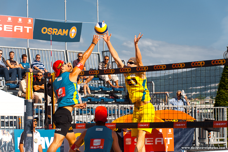 Good Looking Men's Beach Volleyball Player Jumps to Punch a Drop Shot Over Defender - Geneva, Switzerland - Daily Travel Photos