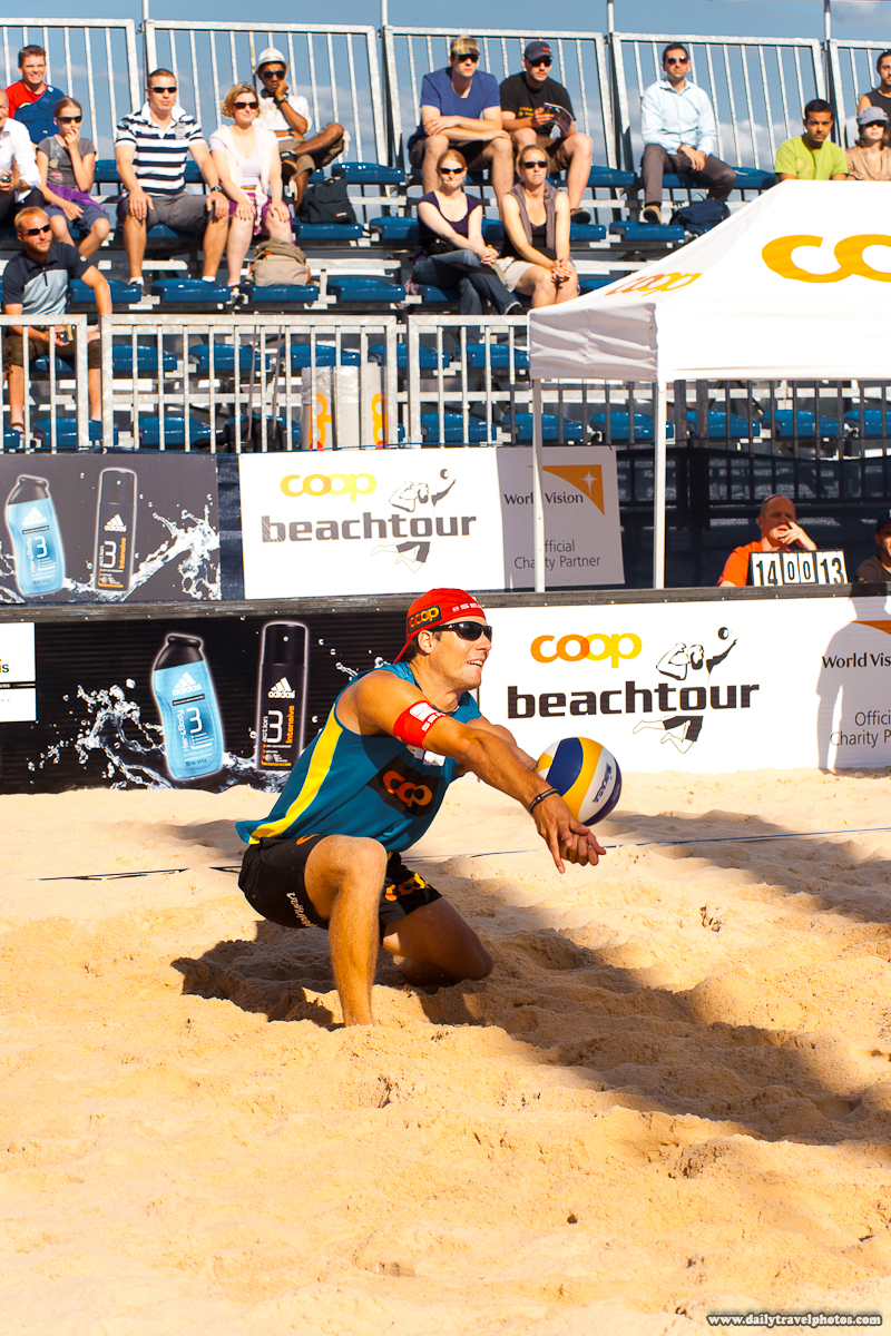 Handsome Men's Beach Volleyball Player Digs a Spiked Ball - Geneva, Switzerland - Daily Travel Photos