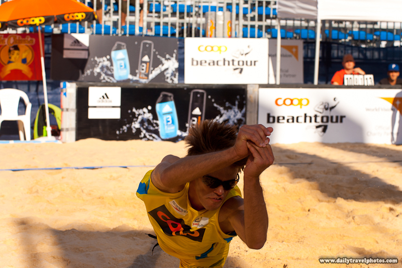 Coop Men's Beach Volleyball Player Dives Body Horizontal to Sand for Dig - Geneva, Switzerland - Daily Travel Photos