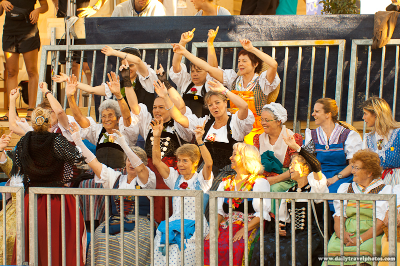 Traditionally Dressed Swiss-German Fans in Stands of Beach Volleyball Sporting Event - Geneva, Switzerland - Daily Travel Photos