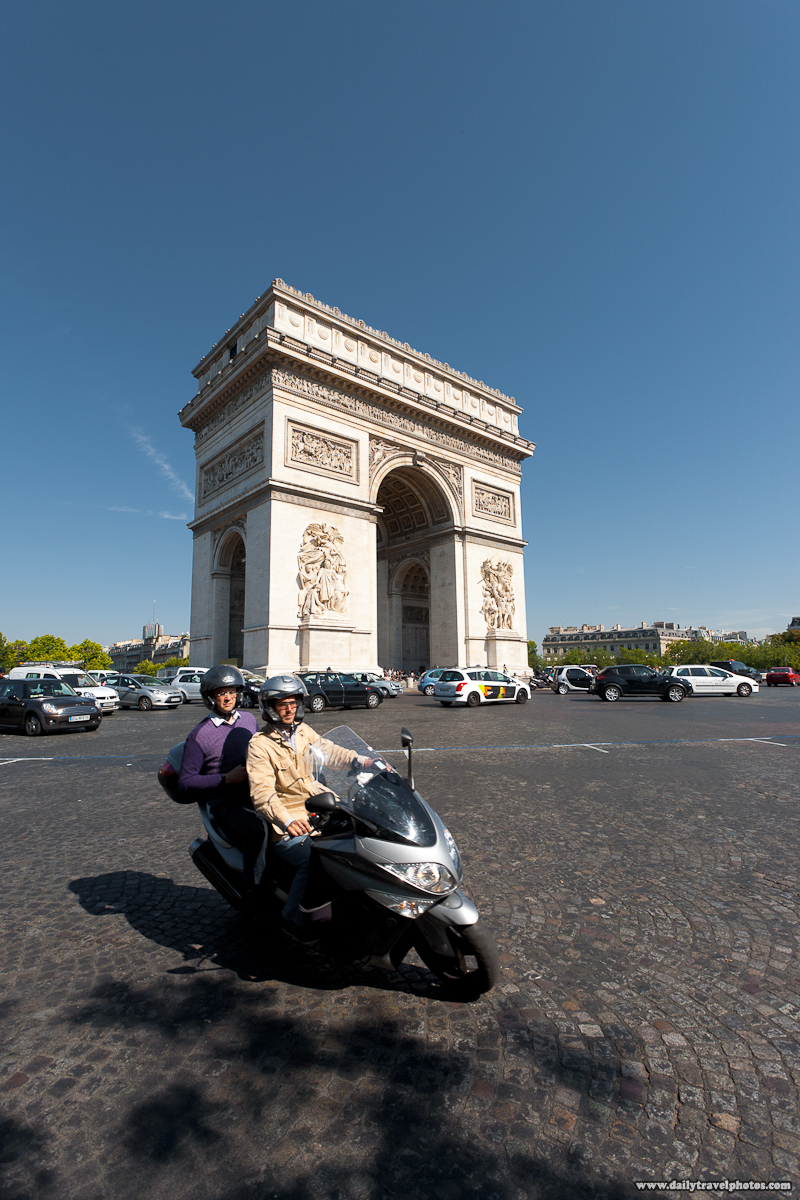Motorcycle Does Leaning Turn At Traffic Circle In Front of Arc De Triomphe - Paris, France - Daily Travel Photos