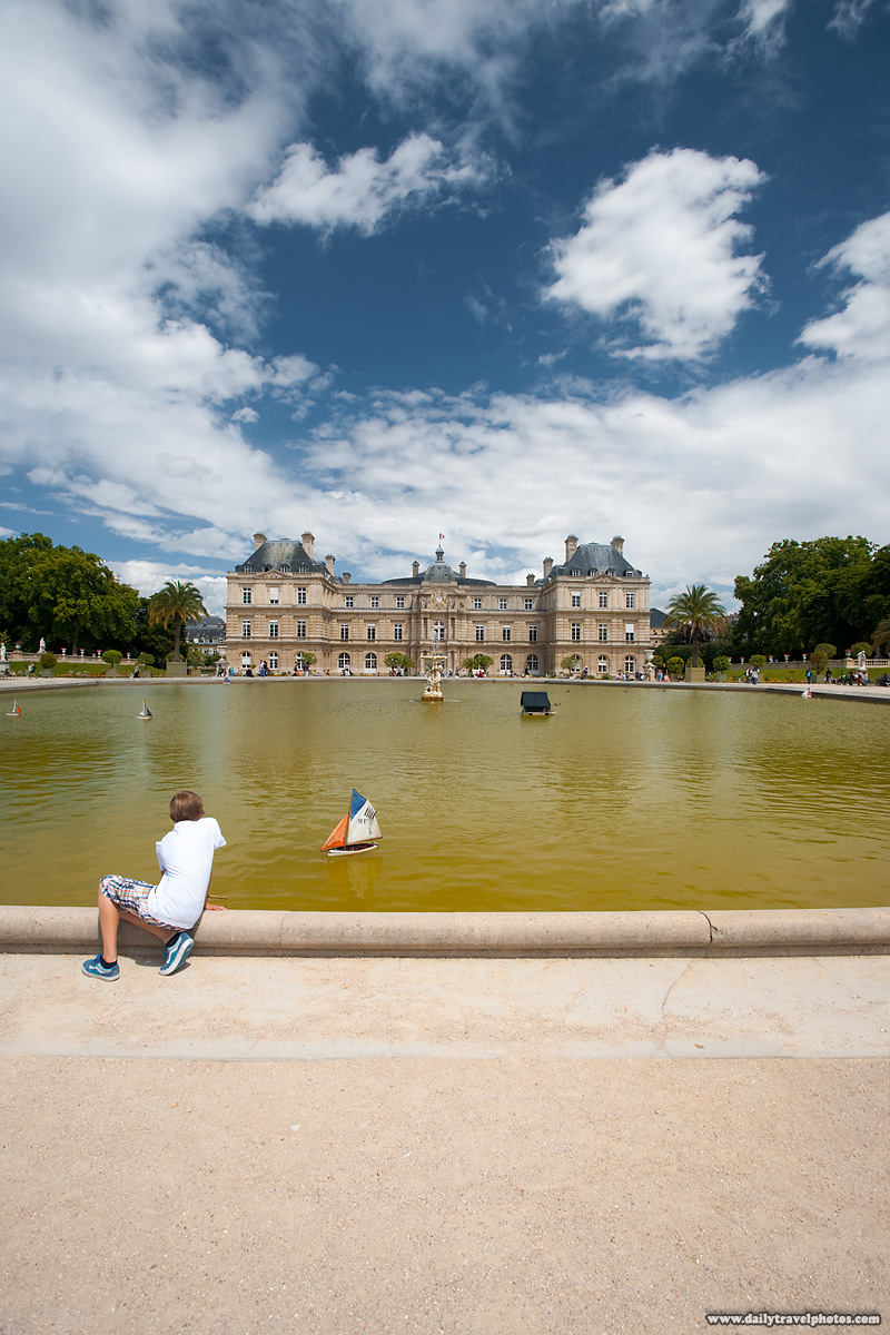 Boy Playing With Toy Sailboat in Fountain of Jardin de Luxembourg Gardens - Paris, France - Daily Travel Photos