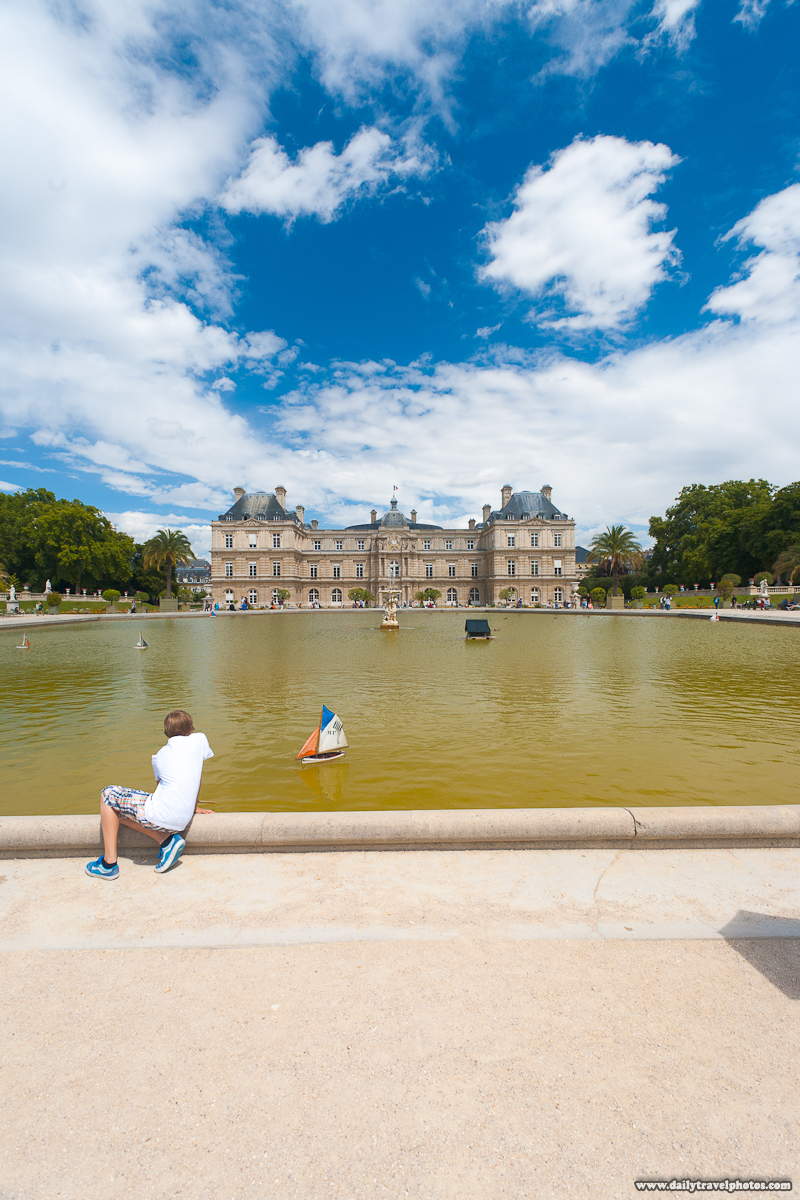 Boy Playing With Sailboat in Fountain of Jardin de Luxembourg Gardens BEFORE Post Processing - Paris, France - Daily Travel Photos