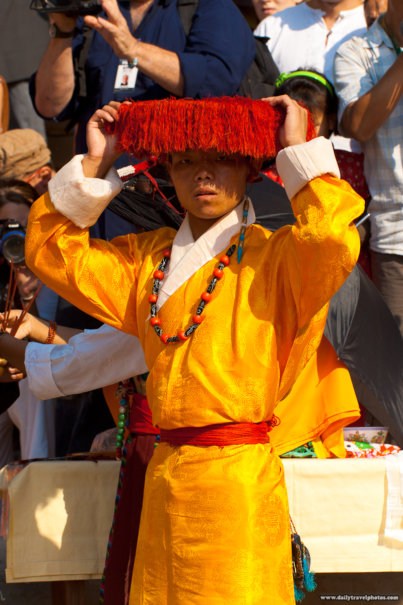 Traditionally Clothed Tibetan Adjusts Hat Before Dalai Lama Arrives - Dharamsala, Himachal Pradesh, India - Daily Travel Photos