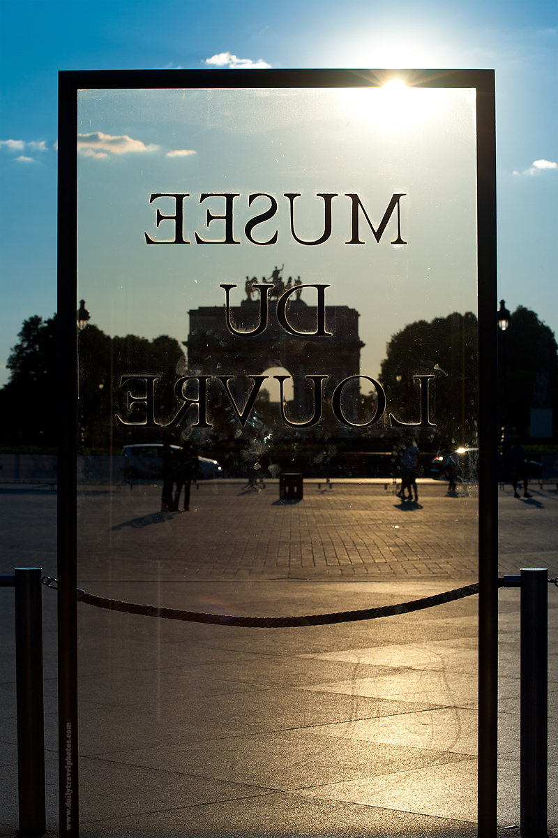 Glass Sign in Front of Louvre Museum - Paris, France - Daily Travel Photos