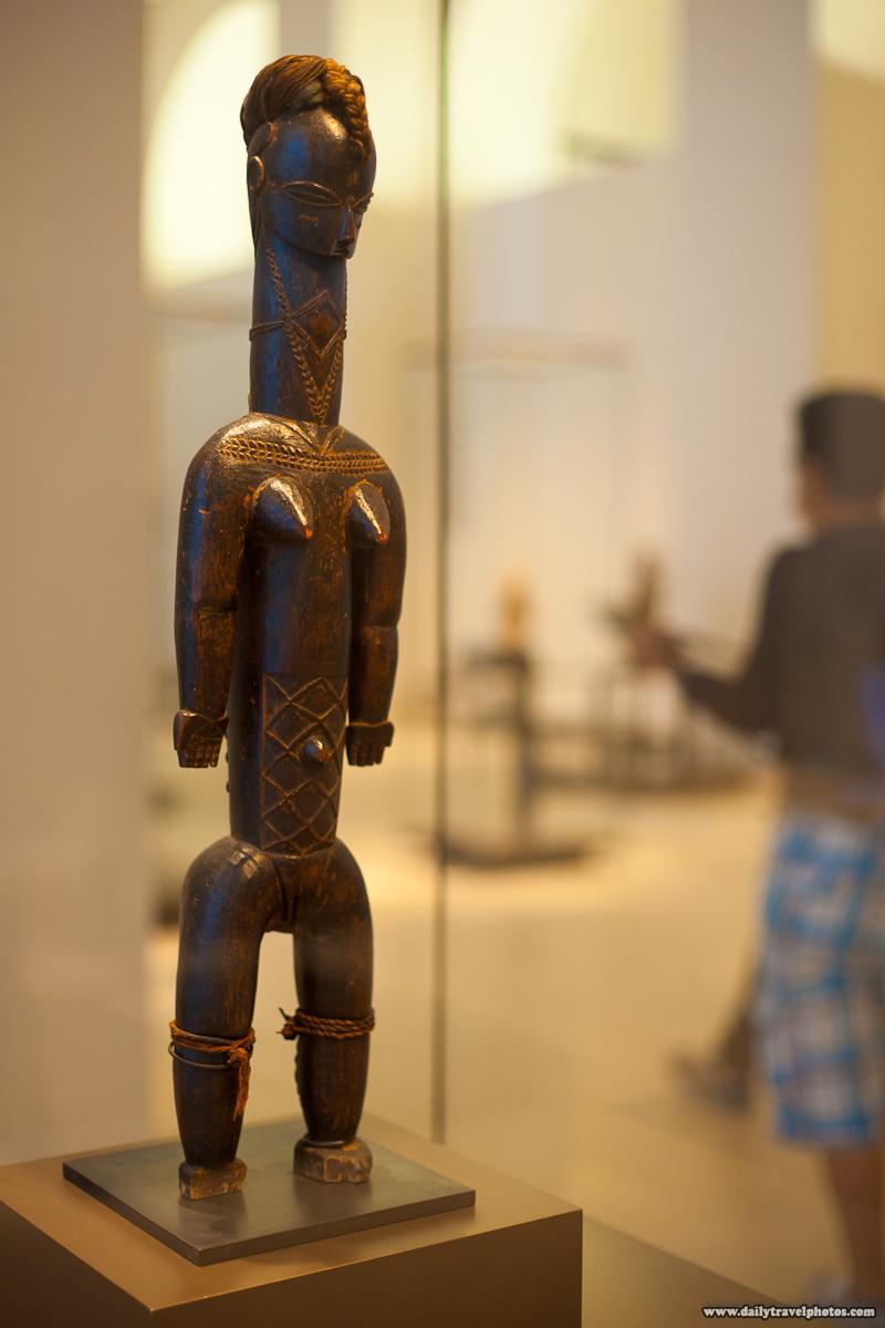African Art Statue Louvre Museum - Paris, France - Daily Travel Photos