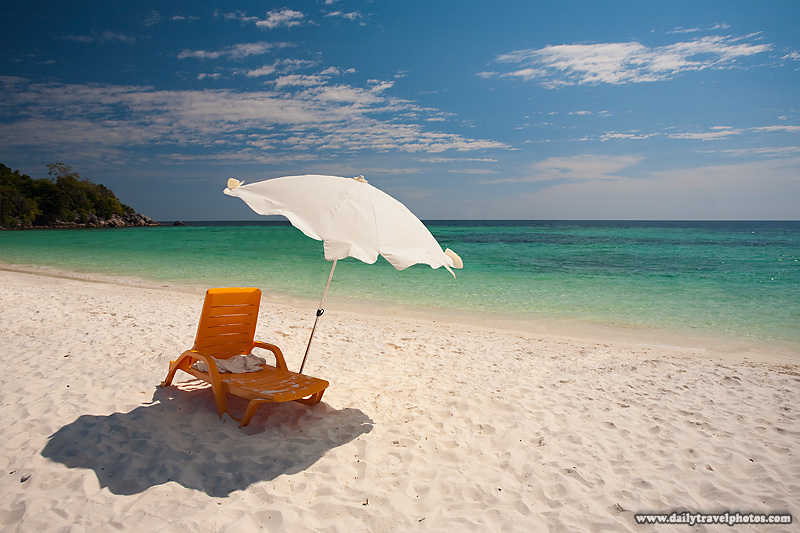 Lone Beach Chair and Umbrella on White Sand Beach and Crystal Clear Water - Ko Lipe, Thailand - Daily Travel Photos