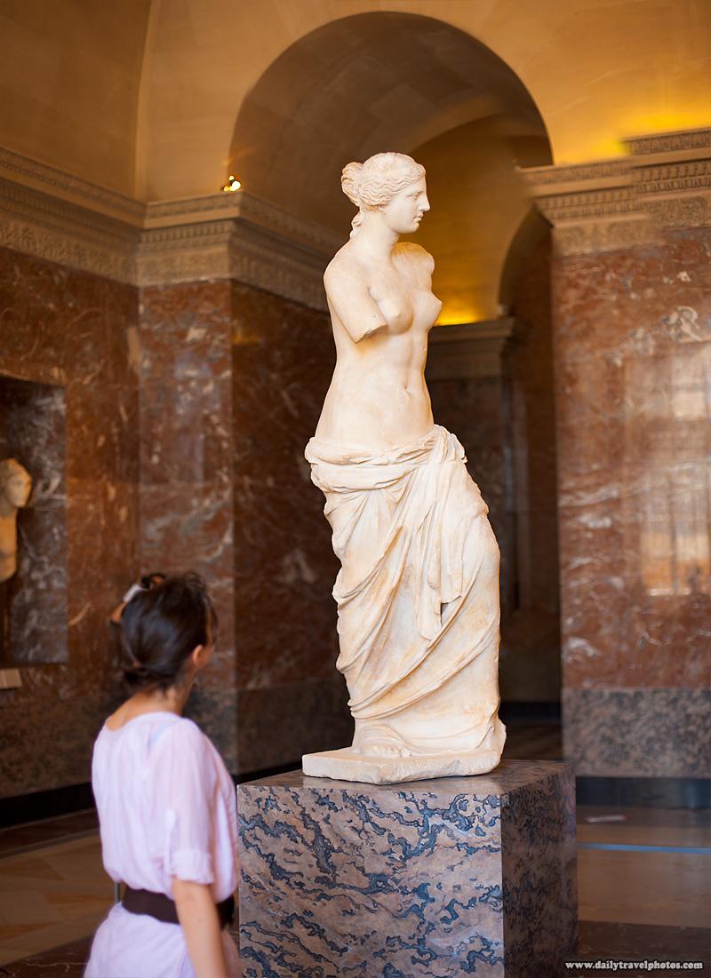 Lone Tourist Views Venus De Milo Statue Louvre Museum - Paris, France - Daily Travel Photos