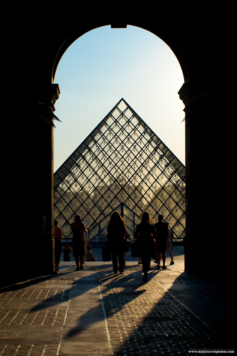 Louvre Glass Pyramid Archway People Leaving at Sunset - Paris, France - Daily Travel Photos
