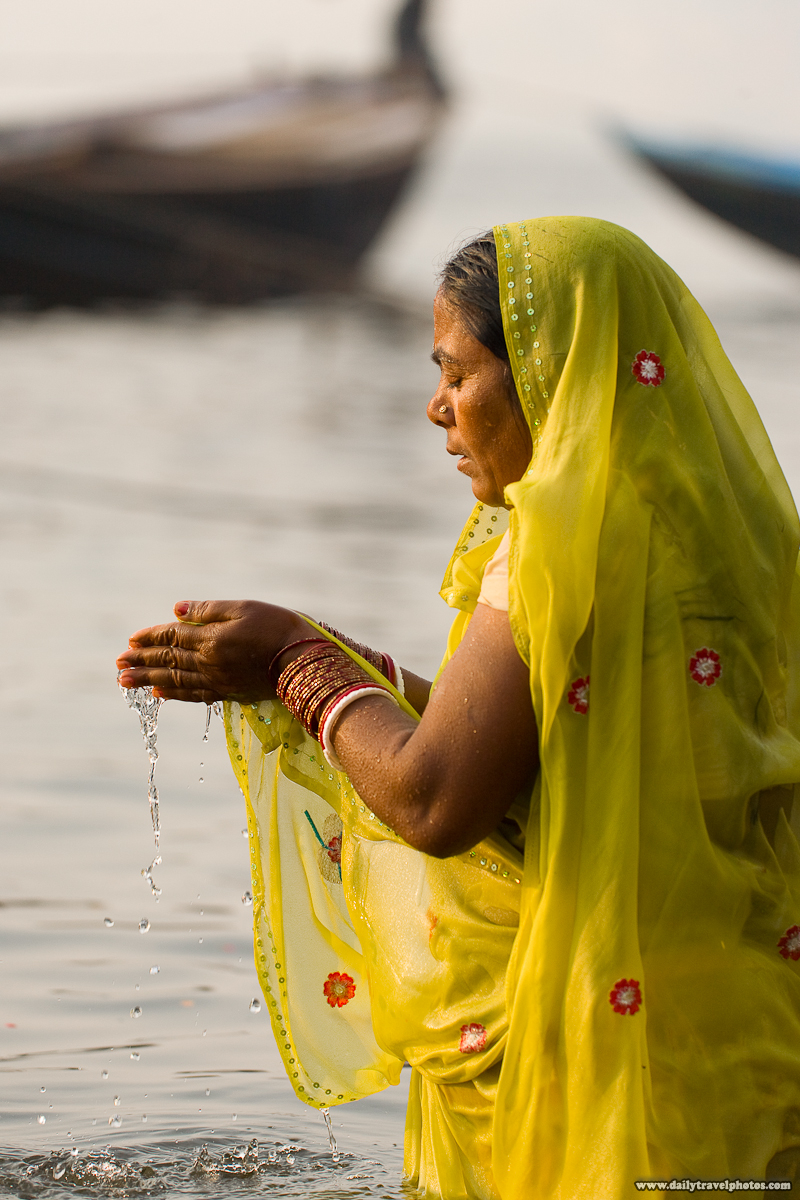 Hindu Woman Morning Bathing Praying in Ganges River - Varanasi, Uttar Pradesh, India - Daily Travel Photos
