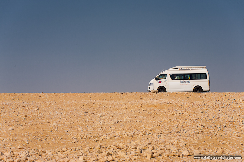 Tourist Van Going to Pyramids Drives Along Horizon in Giza Desert - Cairo, Egypt - Daily Travel Photos