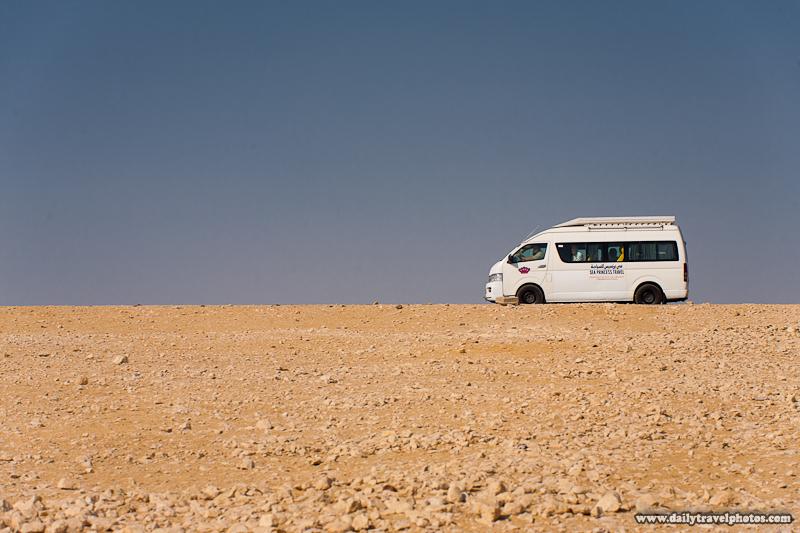 Tourist Van Going to Pyramids Drives Along Horizon in Giza Desert - Cairo, Egypt - Daily Travel Photos